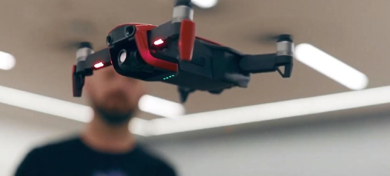 Man flying a mini drone