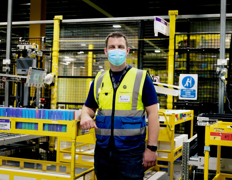 Tony Harris inside Amazon's fulfilment centre in Dunstable