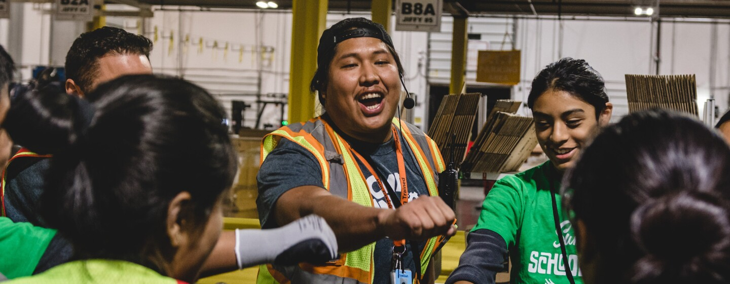 Amazon fulfillment workers cheering each other