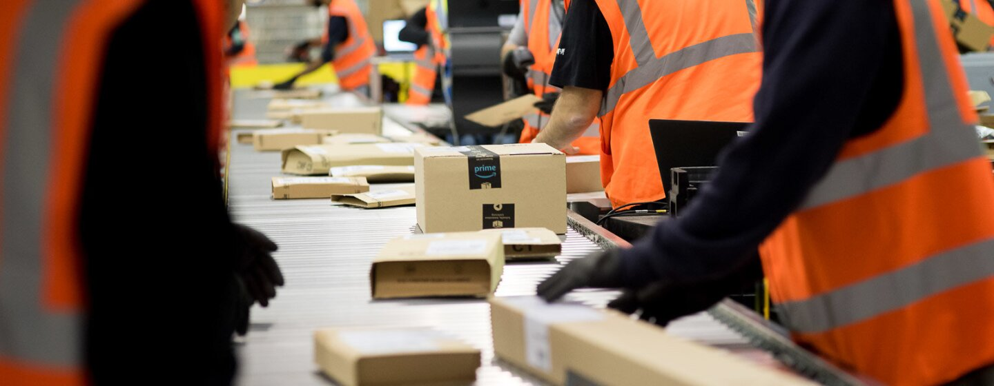 Amazon Fulfillment Center employees working