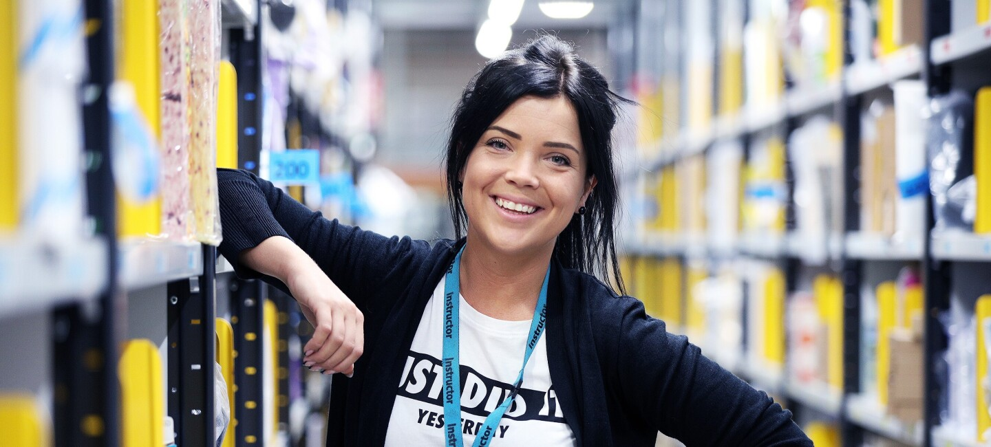 Ieva Rubina, fulfilment centre employee at Amazon in Peterborough, pictured at work