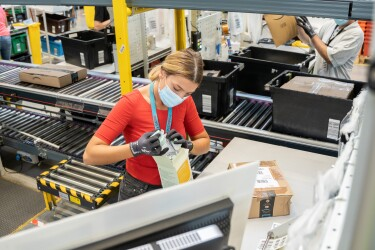 amazon employee inspects returned products at fulfilment centre