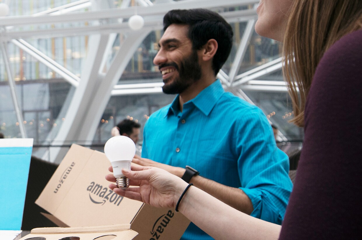 Three Amazon employees discuss Frustration-Free Packaging during a meeting in the Amazon's Seattle Spheres.