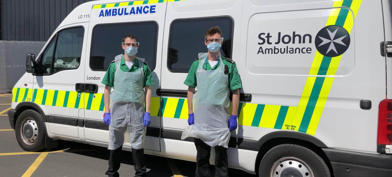 Paramedics stood next to St John ambulance