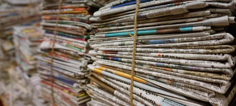 Stacks of newspapers bundled together