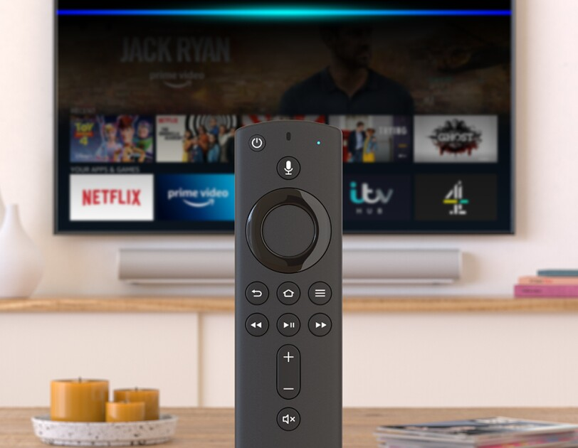 Fire TV remote in front of a television.