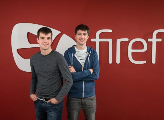 Founders looking directly at the camera and smiling