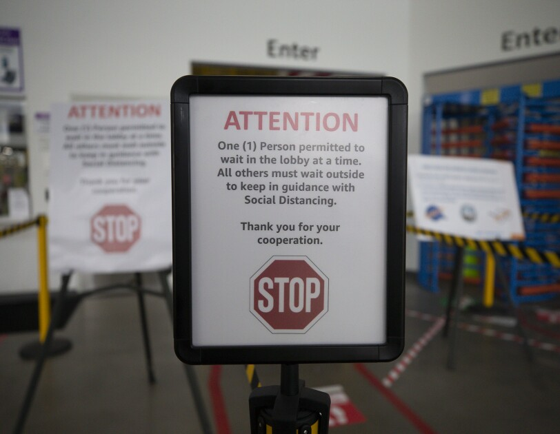 A sign at an Amazon fulfillment center noting social distance requirement