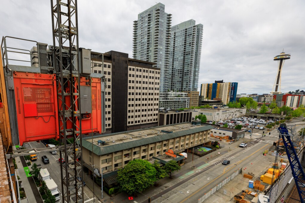 Buildings under construction on Amazon's South Lake Union campus. View from a building under construction, overlooking the former Mary's Place location, with the Space Needle in the background.