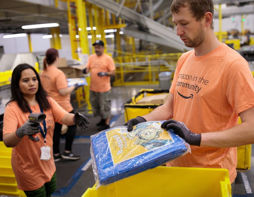 Amazon associates prepare tarps and other products for those impacted by Hurricane Dorian.
