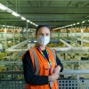 Sarah Jones, WHS Coordinator at Amazon's fulfilment centre in Swansea, stood on a mezzanine with the shop-floor in the background