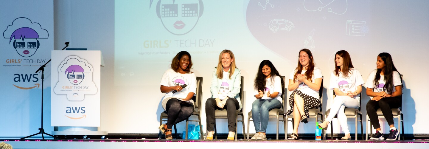 AWS InCommunities - Participating ladies and representatives of AWS, among them Cornelia Robinson, Global Leader of AWS InCommunity sit on stage and talk during an AWS InCommunity event