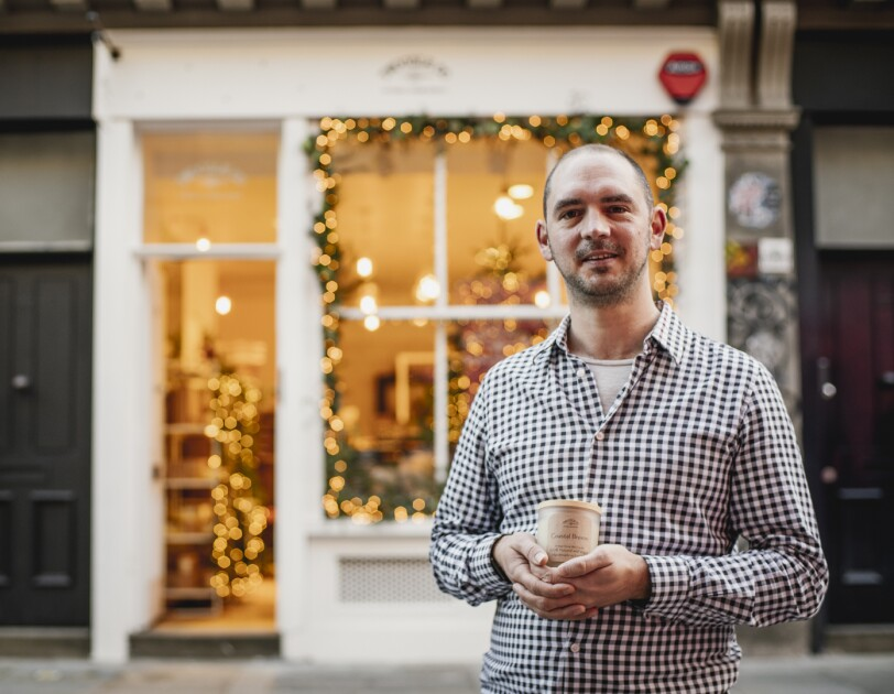 Tim Rundle-Wood, founder of Twoodle Co, in front of his shop in London