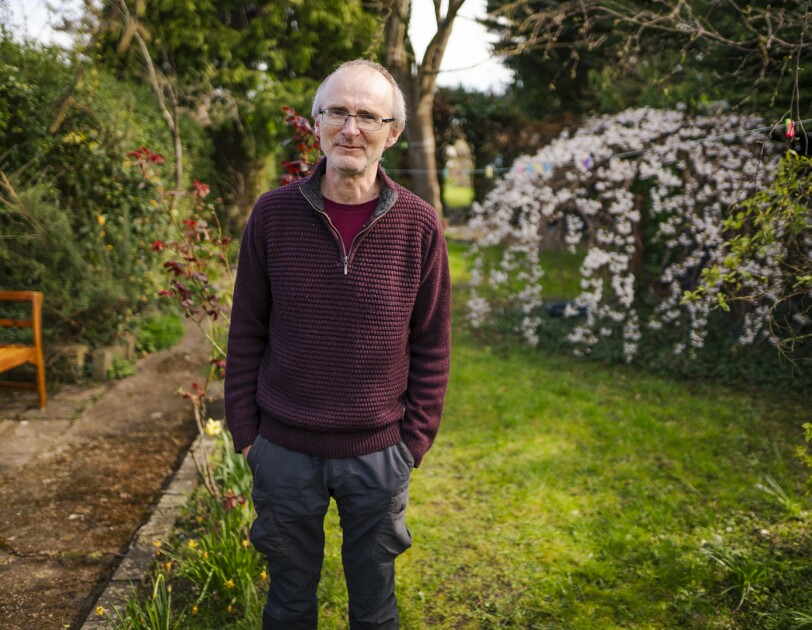 Portrait of Andrew Trehearne, who is taking part in UK Biobank's Long Covid research, in his garden