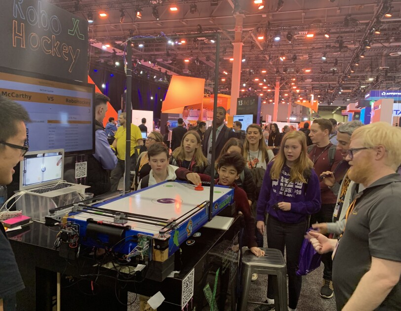 GetIT students playing air hockey at re:Invent event in Las Vegas