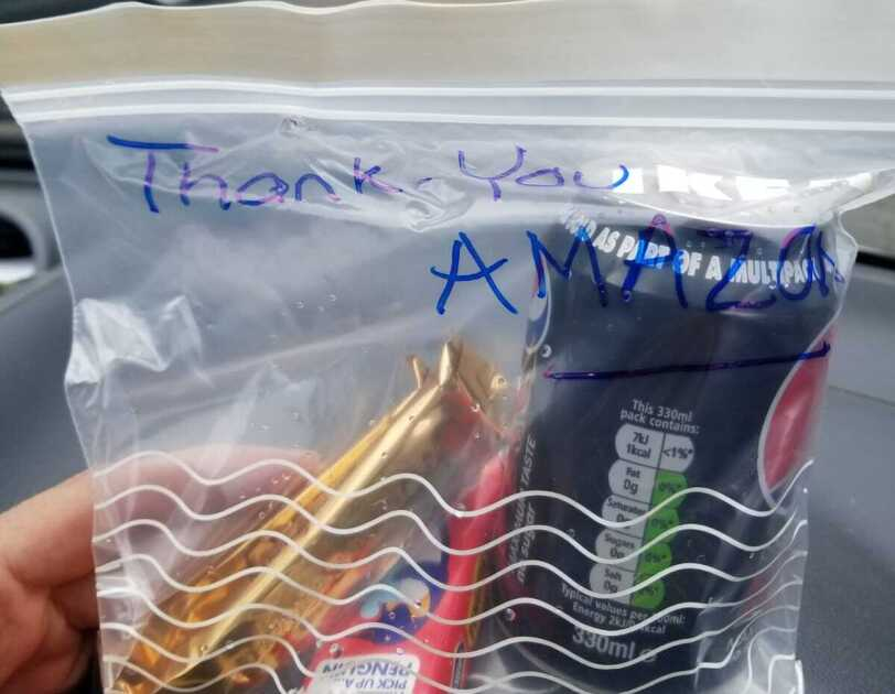 A zip lock back with a drink and snacks in it for an Amazon delivery driver. The bag has 'Thank you Amazon' written on it.