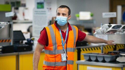 Amazon employee, Aman Thukral, wearing a face mask and giving a tour of the new safety measures in fulfilment centres.