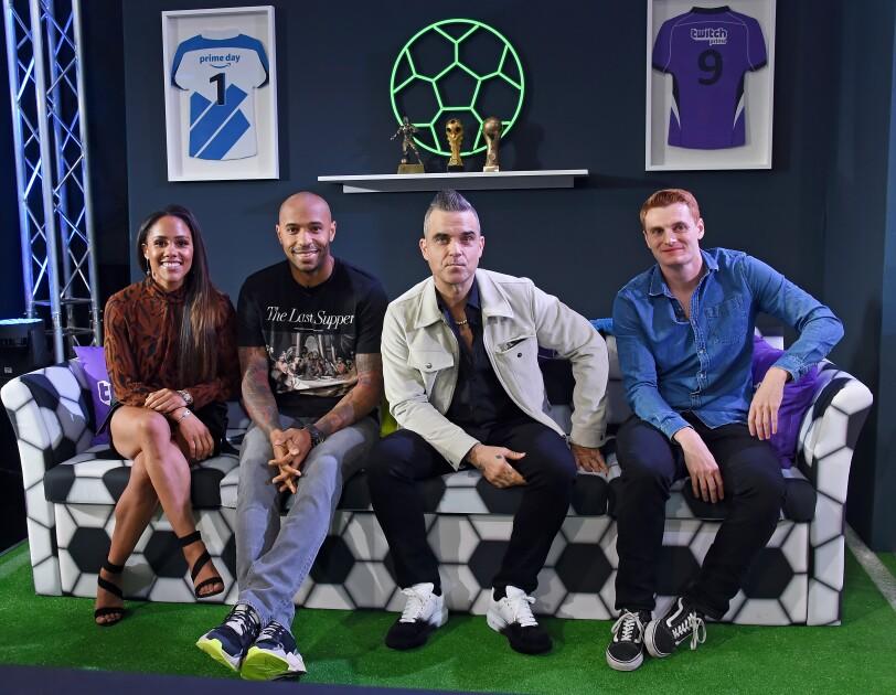 Alex Scott, Thierry Henry, Robbie Williams und CapGunTom blicken herausfordernd in die Kamera