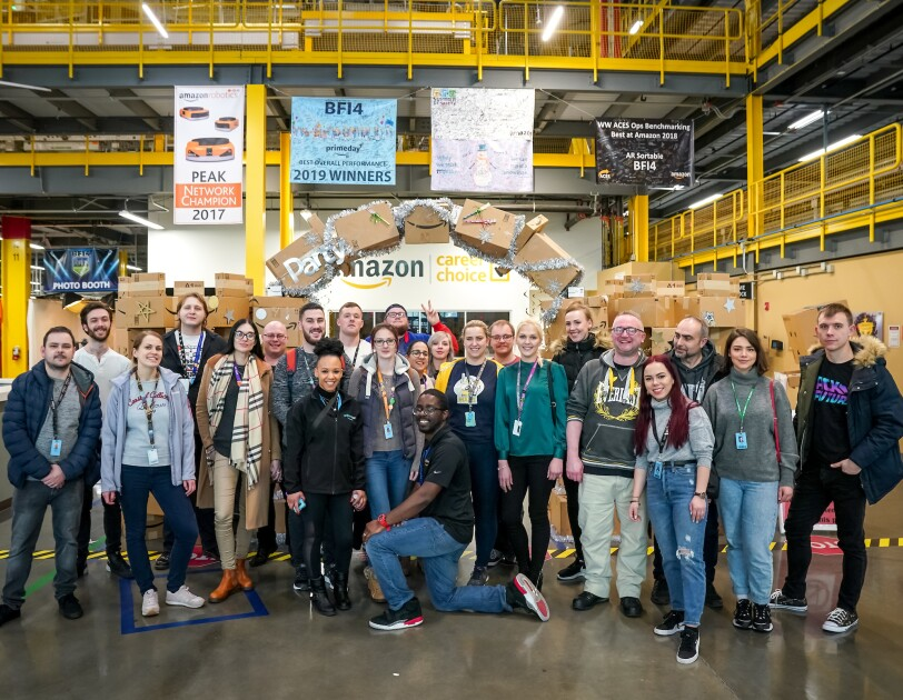 A group of Amazon employees on the 'I found the right place' programme standing in the Fulfilment Centre in Kent, Washington on a fulfilment centre tour.