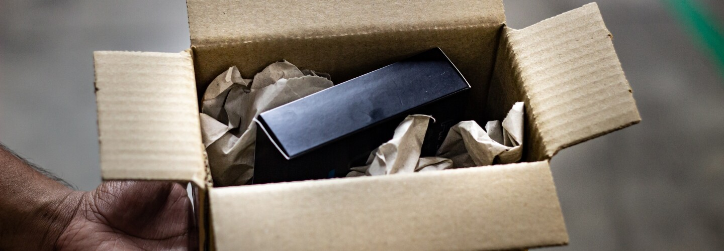 A box with paper dunnage hence doing away with Plastic free packaging