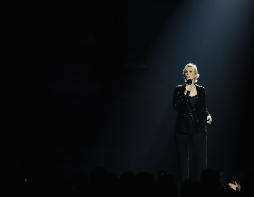 Stills from Prime Day 2019 concert featuring Taylor Swift, Sza, Becky G., and Dua Lipa, hosted by Jane Lynch.