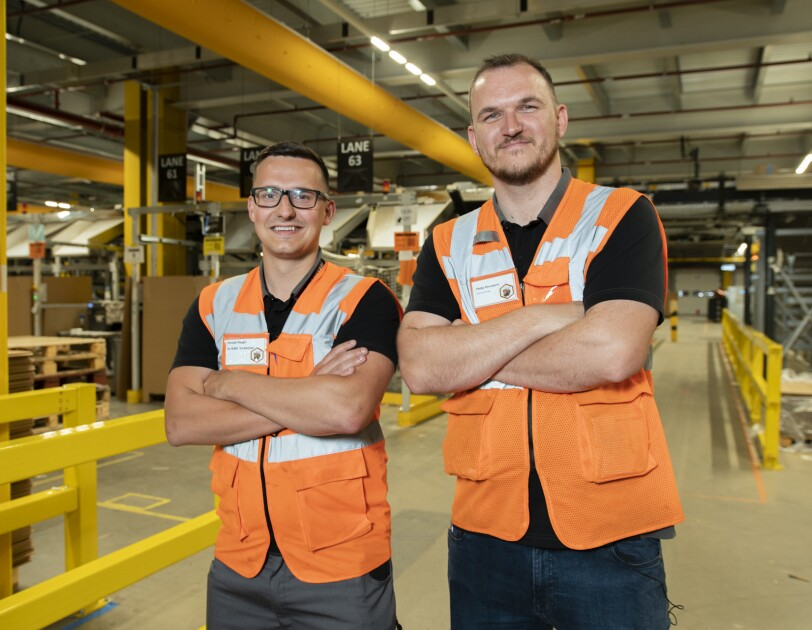 Military veterans Phil Davenport and Joe Haggis in an Amazon fulfilment centre
