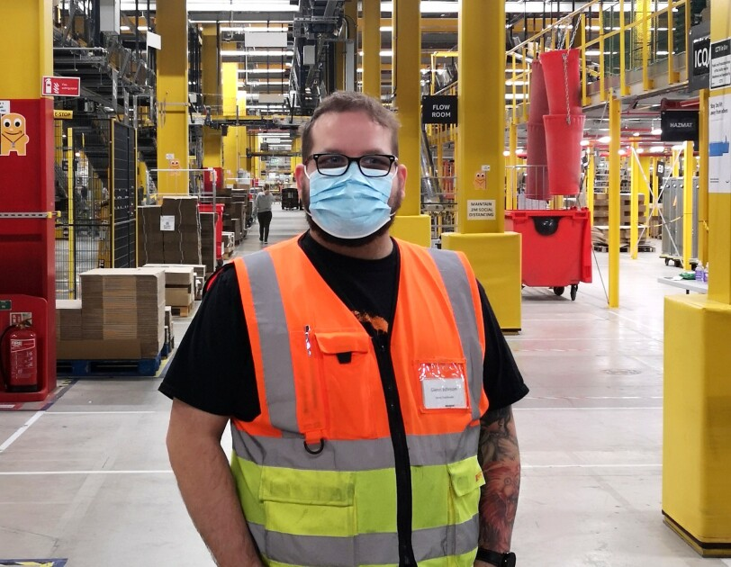 Glenn Johnson, Stores coordinator at Amazon fulfilment centre in Warrington, pictured in a high visibility vest and face mask