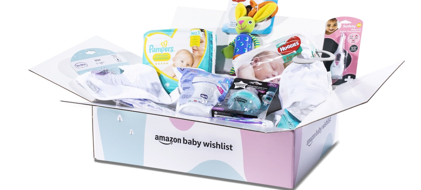 An Amazon Baby Wishlist Welcome Box overflowing with products for expectant parents