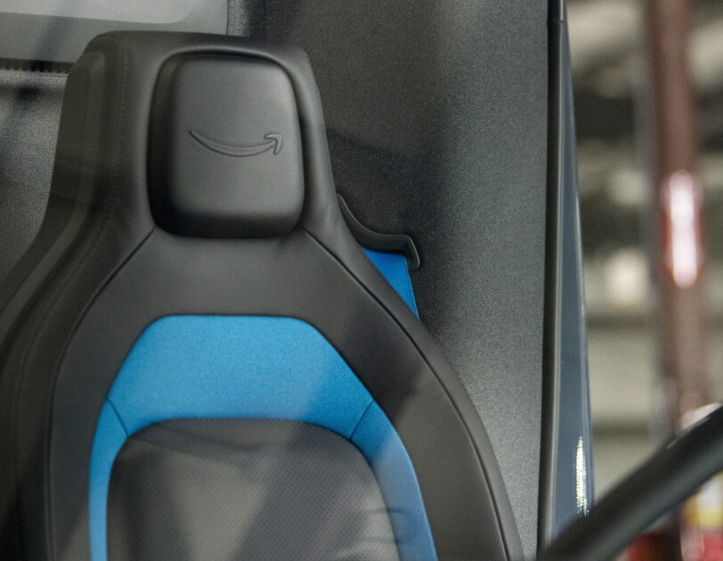 A close up image of the drivers seat in Amazon electric delivery vehicle.