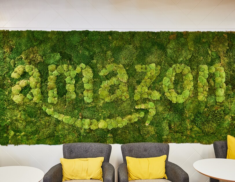 Amazon Development Centre in Edinburgh green background