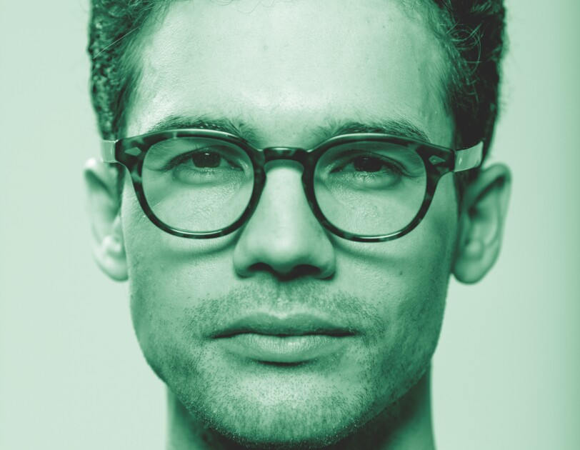 """Steven Strait, from the Amazon Originals series """"The Expanse"""" poses for a photo. The image has been treated with a green filter."""