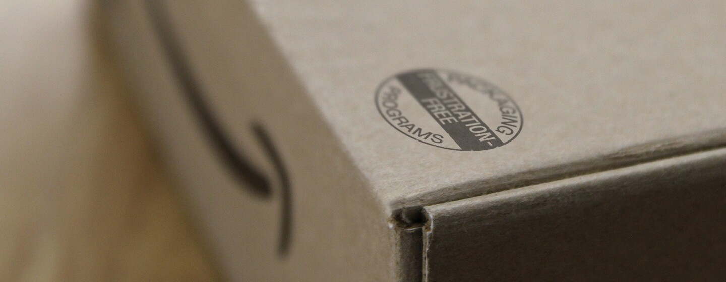 "An Amazon box box with a seal that reads ""Packaging Programs"" ""Frustration-Free""."