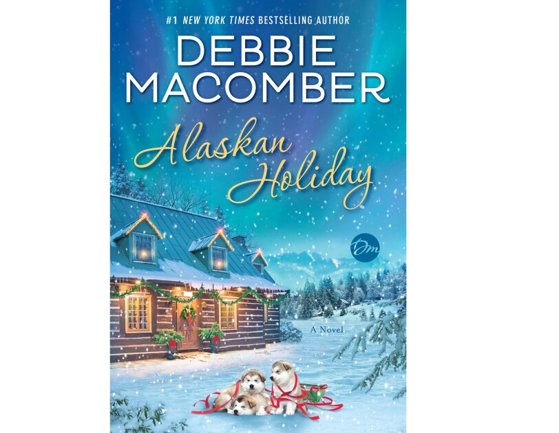 """Alaskan Holiday "" book cover, shows a cozy cabin with festive lighting, in front of the house sit three husky dugs, cuddled together on a blanket of snow. Snow falls gently around the home and dogs."