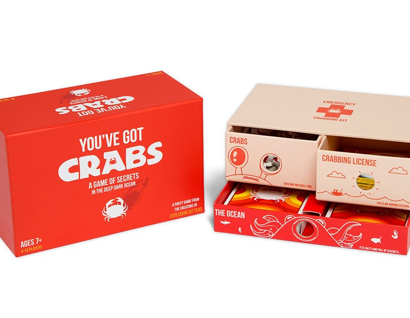 A family-friendly party game called You've Got Crabs, which includes 78 cards, instructions, foam turn indicator, 28 crab points and a box with 3 drawer compartments