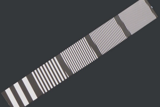 Alternating black and white lines are spaced widely apart on the bottom left of the image and packed close together on the top right.