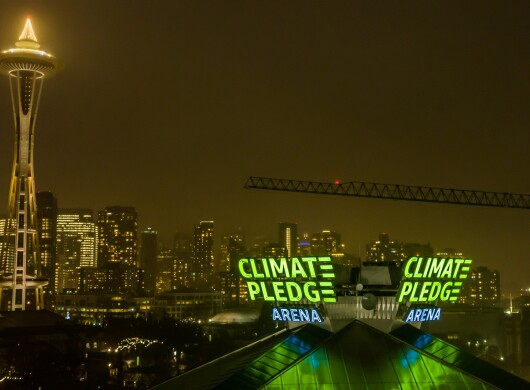 Photo of the Seattle skyline with the Climate Pledge Arena and the Space Needle