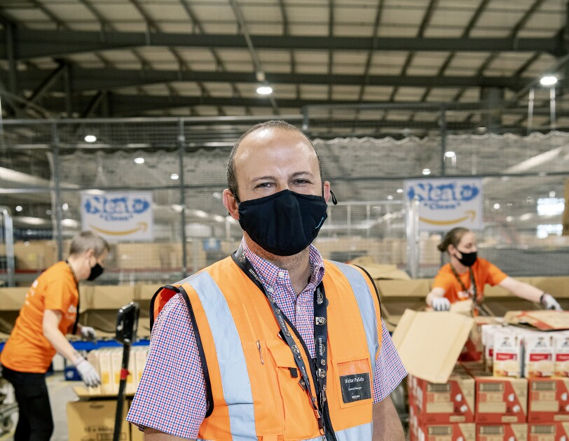 Amazon employee with food donations in fulfilment centre