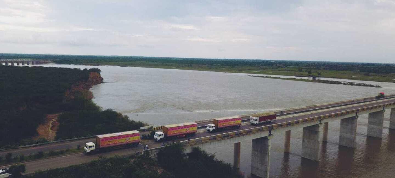 Amazon Yatra convoy passes a bridge