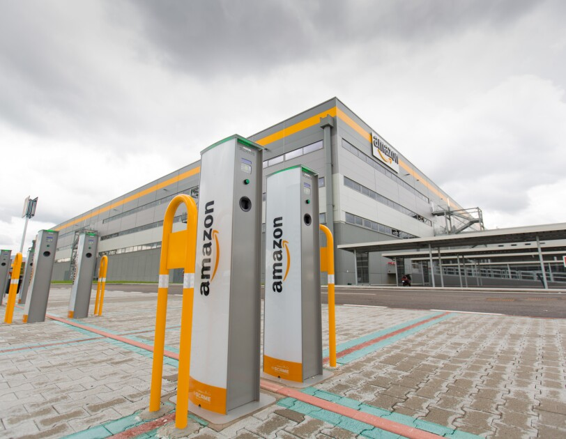 An electric car charging station outside of an Amazon fulfillment center in Italy.
