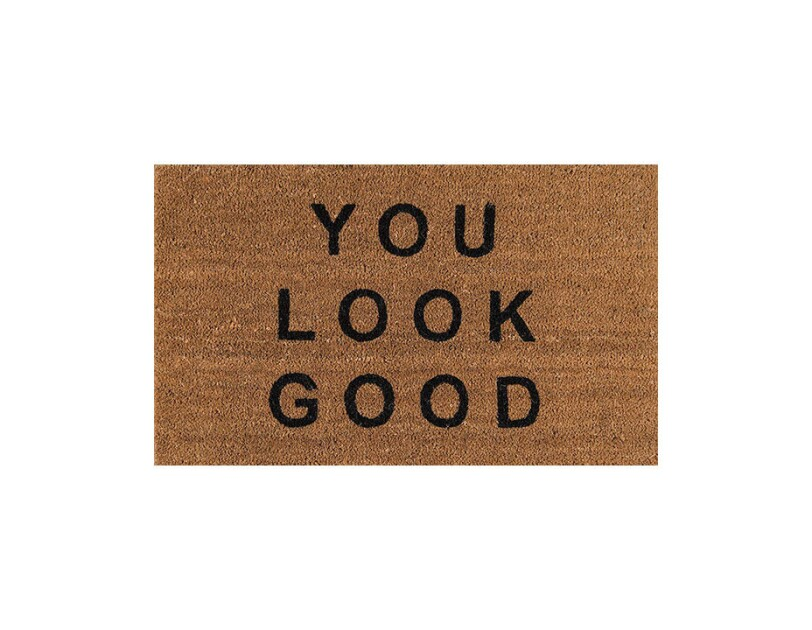 "Coir door mat with ""you look good"" printed across the top."