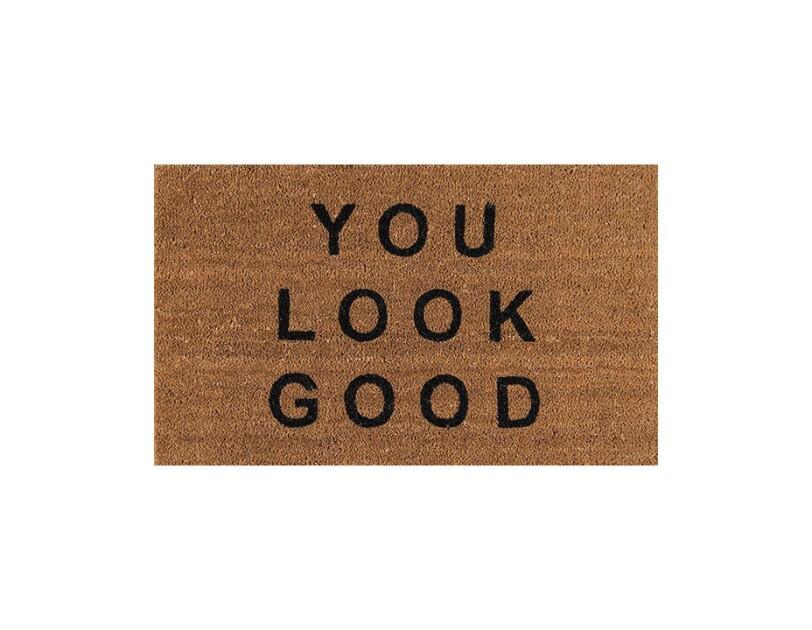 """Coir door mat with """"you look good"""" printed across the top."""