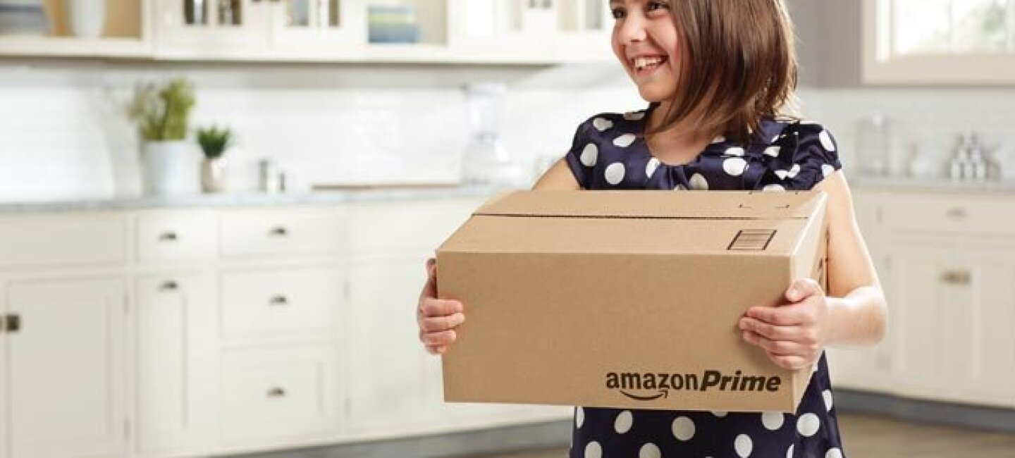 Girl holding Amazon Prime box