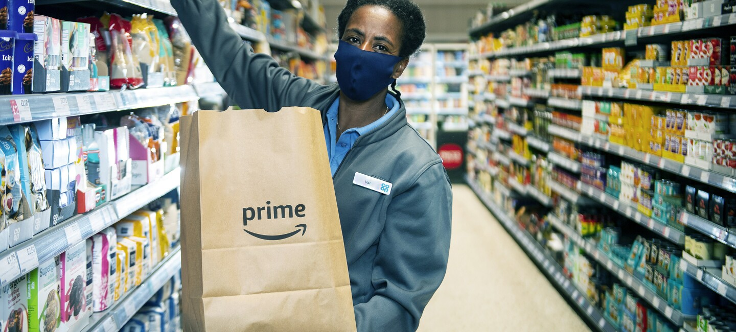 Val Murray Co-Op team member collecting items for amazon prime order in Glasgow