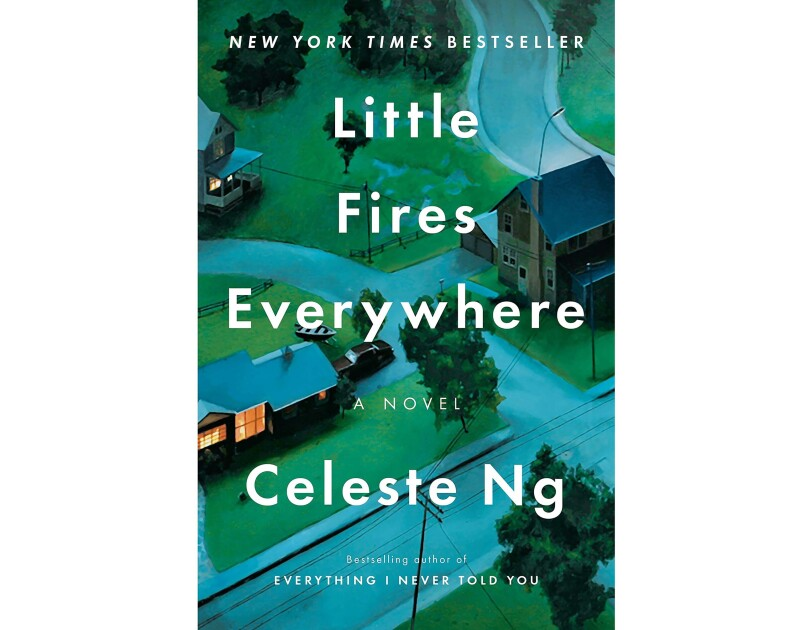 A neighborhood scene with lush green lawns, trees, and houses near one another. The book title, Little Fires Everhwyere, is in white print.