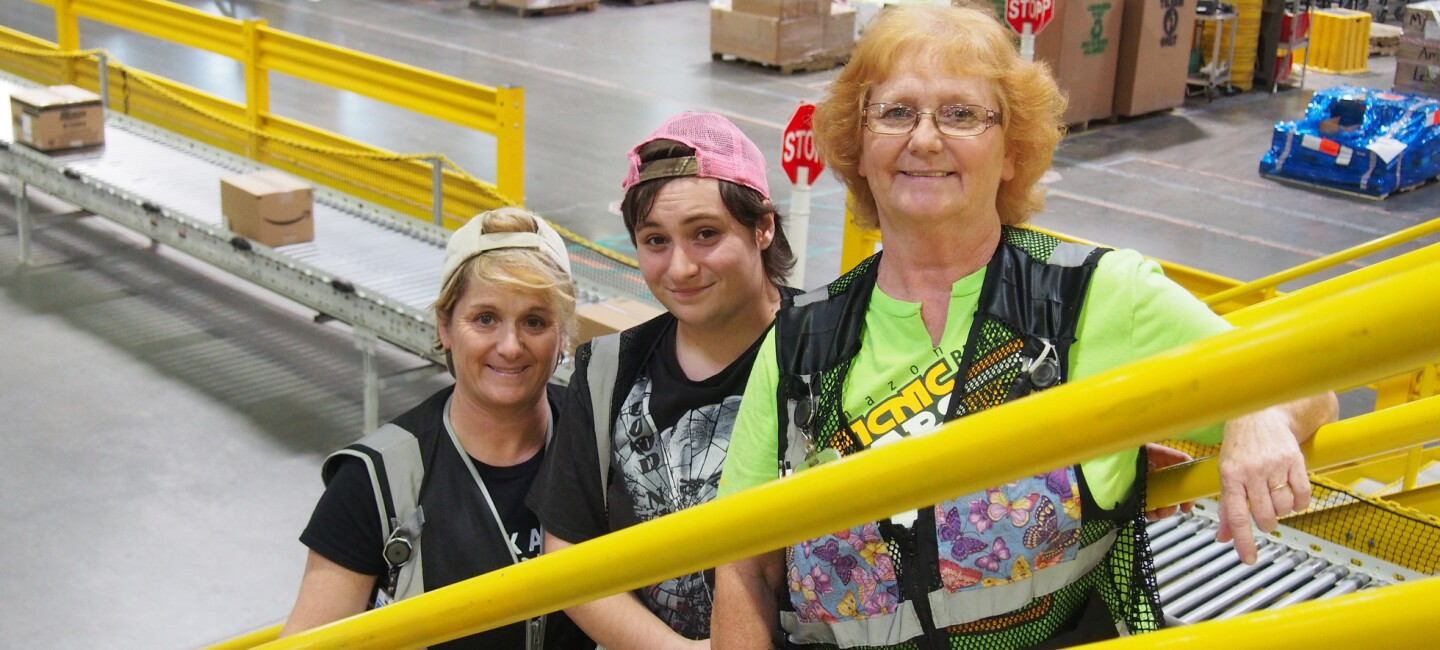 Grandmother, mother, and daughter who work together at an Amazon fulfillment center