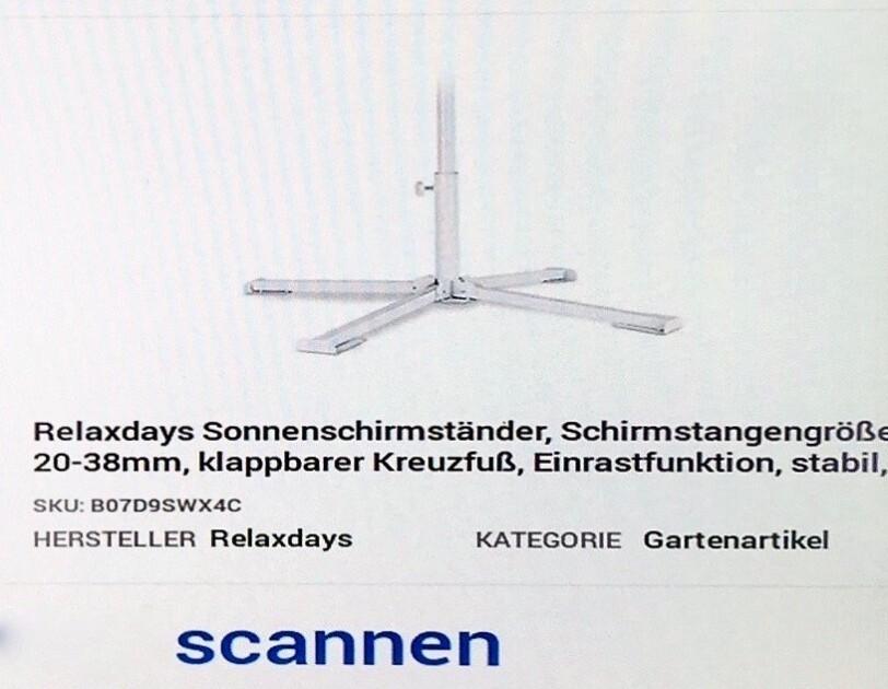 """Ein Bildschirmscreenshot des Amazon Systems ist zu sehen. Darauf ist zu lesen """"Artikel scannen"""" und die Artikelbezeichnung: Relaxdays Sonnenschirmständer, Schirmstangengröße 20-38 mm, klappbarer Kreuzfuß, Einrastfunktion, stabil, Kategorie: Gartenartikel"""