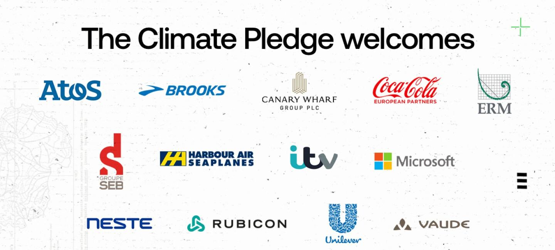 Sobre un cuadro blanco los logos de Atos, Brooks, Canary Wharf Group, Coca-Cola European Partners, ERM, Groupe Seb France, Harbour Air, ITV, Microsoft, Neste, Rubicon, Unilever, y Vaude  con un texto de The CLimate Pledge welcomes.