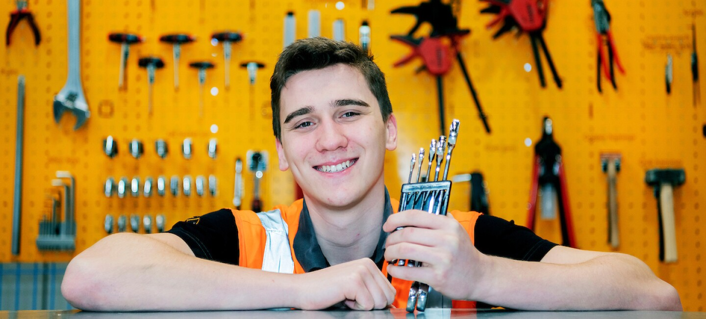 Mechatronics apprentice, Luca Stanislawski, pictured with tools