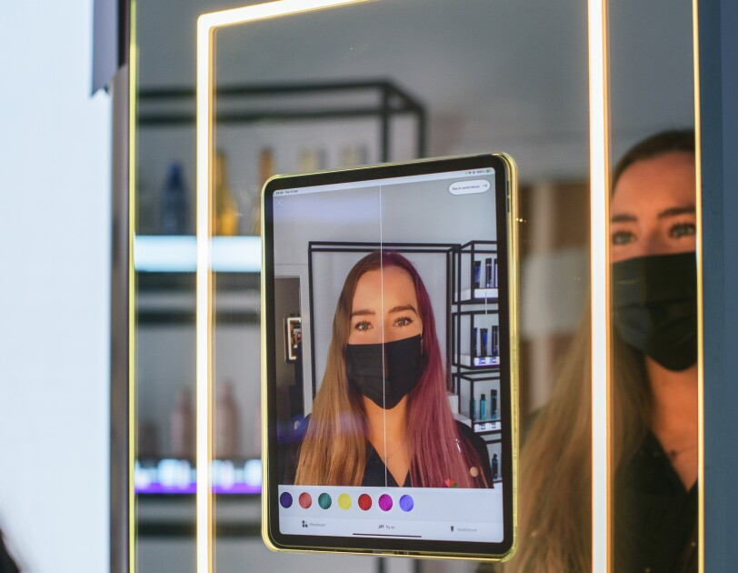 woman using AR in the Amazon Salon, London