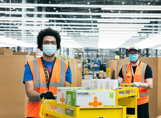 Amazon creates a special online store where the government can procure medical equipment. These supplies are packed and shipped from their Coalville Fulfimlent Centre (BHX2), Leicestershire. (l&r) Mohamed Elsaka (elsakm) and Adrian Goloiu (agoloiu) pick medical supplies for an order.